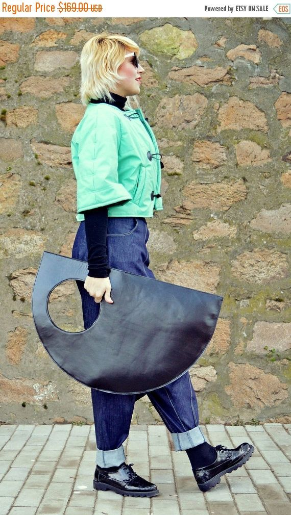 Genuine leather bag, extravagant and so easy to wear. Large bag, versatile and fun, that can carry the necessary everyday things. Extravagant bag that will jazz up your wardrobe and conquer the urban scene!  Material: 100% genuine leather  Size: Length - 31.5 (80 cm) / Width: 19.6 (50 cm)  The denim drop crotch pants in the photos: https://www.etsy.com/listing/501198281/blue-drop-crotch-pants-extravagant-blue  The turquoise bolero: https://www.etsy.com&...