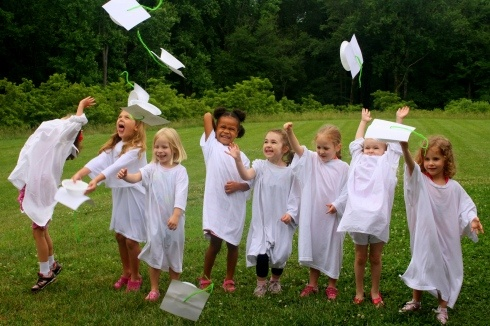 so cute :) preschool graduation with homemade cap and gown (large white shirt and bowl/paper)