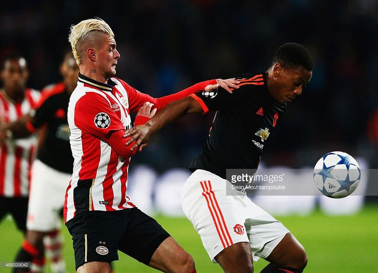 Anthony Martial of Manchester United is challenged by Maxime Lestienne of PSV Eindhoven