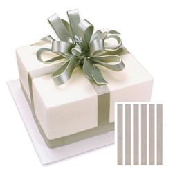 "Edible Image® Shimmer RibbonsT- Silver  Create a stunning finish with edible image® shimmer ribbonsT.  Looks like a satin ribbon and is completely edible.  Great because ribbon doesn't need to be removed before the cake is cut.  Works on many types of icing including buttercream, chocolate, fondant, non-dairy whipped icing and cream cheese icing.  Each package contains 6 ribbons of the same design measuring 1"" wide by 10 1/2"" long.  Edible Image® is a registered trademark of The Lu..."