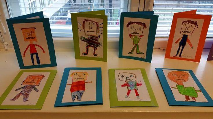 Isänpäiväkortti: Ekaluokkalaiset leimasivat viikset ja kirjaimilla silmät+nenän ja piirsivät ympärille sarjis-isin, jolla on iso pää ja pieni vartalo. Leimatun naaman idea viimevuoden Meilahden ekojen opeilta. (Alkuopettajat FB -sivustosta / Tiia Kekkonen)