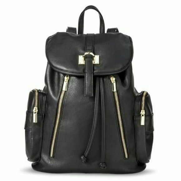 Target Black & Gold Leather Backpack Faux, soft leather backpack with gold detailing! Perfect condition. Very spacious on the inside, can fit a 3inch binder or multiple textbooks. Has adjustable straps! Multiple exterior pockets. Mossimo Supply Co. Bags Backpacks