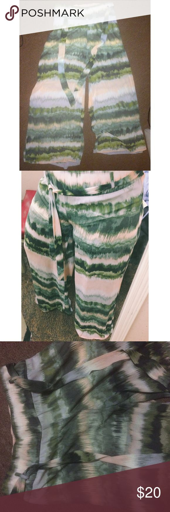 Beautiful Resort Wide Leg Pants It's super lightweight . Wide legs . Belt hoops and a belt . Has a shorts as the lining . Nice waterfall type pattern . Last pic shows where an elastic band popped , doesn't change the function of the pants. Good for Large to XL . Great for summer on the beach or by the pool 👙👒🌊💦I'm open to offers . Usually ship next day if purchased by 12pm. Pants Wide Leg
