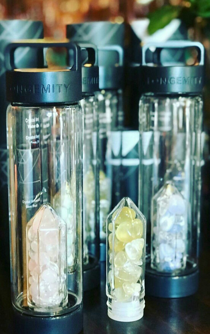 Longemity Crystal Infused Water Bottles with interchangeable gem pods. Luxurious hydration on the go