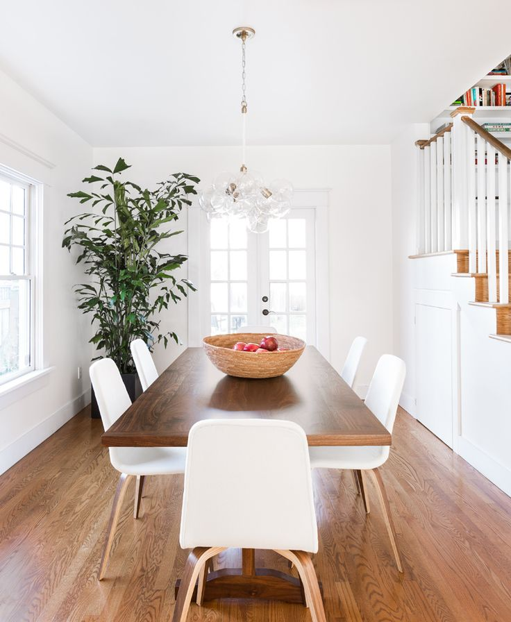 A Sunny Bohemian Home in Seattle   Interior Design by Heidi Caillier of Heidi Caillier Design   Photography by Haris Kenjar   Modern Sanctuary   Dining Room Inspiration   Dining Room   Modern Dining Room   Lighting   Modern Lighting   Lighting Inspiration