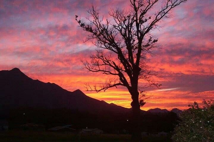 Beautiful early morning winters day sunrise over the Outeniqua mountains in George, south africa