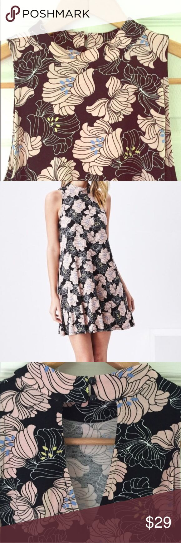 Floral Festival Dress XS/S Lightweight mini dress with high collar and pretty back detail with button closure. Very flowy and roomy in the hips. Great dress, (it also machine washes very well)! Unlined but not sheer. I wear mine with leggings. I wear a small and I am a size 6, but I think I could easily wear the XS as well. Smoke-free home. 95% Rayon, 5% Span. *📷 photo used with permission from Sadie and Sage* Sadie & Sage Dresses