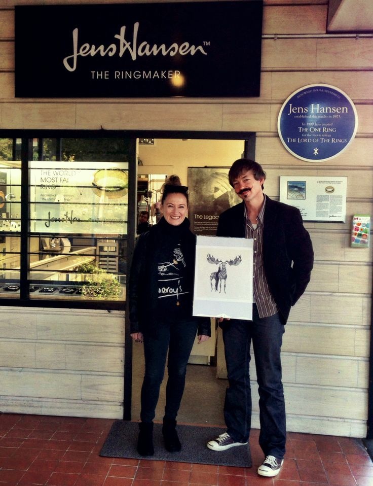 """We love getting a visit from one of our lucky winners! Here Damara Pearl is, outside the studio, collecting her J.R.R. Tolkien-inspired art print """"An Unexpected Journey"""" with Halfdan Hansen."""