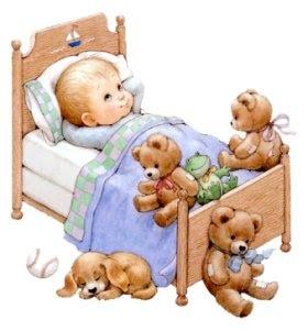 Menininho na cama com seus bichinhos de pelúcia