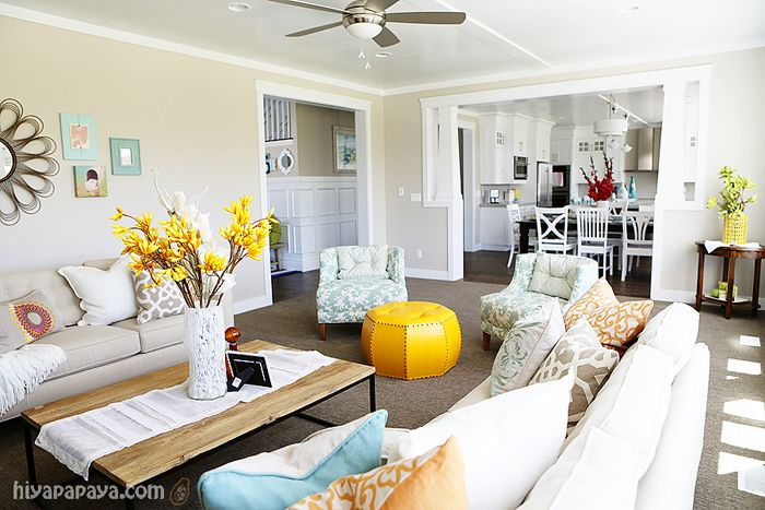 This is exactly what I want!  Beautiful family room. neutral with pops of color.