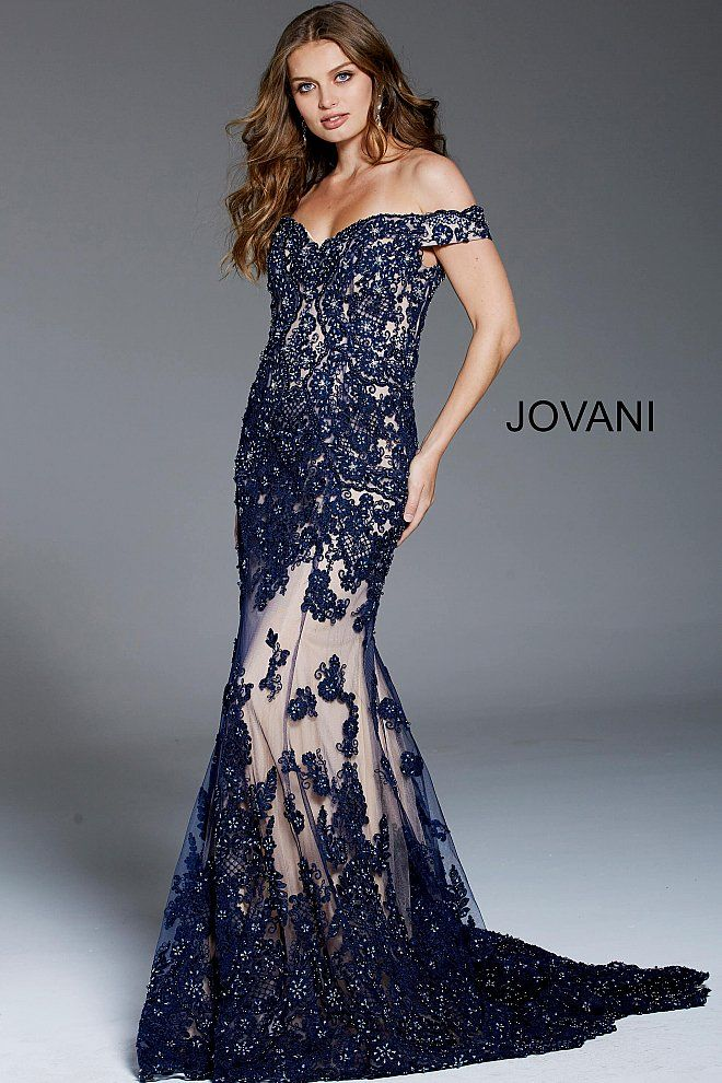 25752350f8b8 Floor length form fitting embellished navy tulle evening mermaid gown with  nude underlay and train features off the shoulder sweetheart neckline.