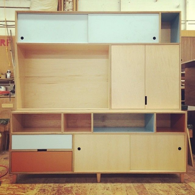 Maple europly media cabinet with colored laminate and maple tapered legs. HYFR. Made by Kerf Design kerfdesign.com