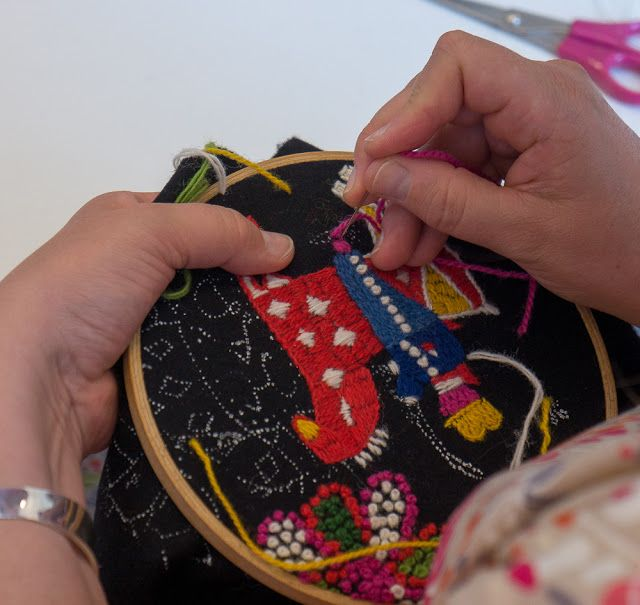 with needle and thread
