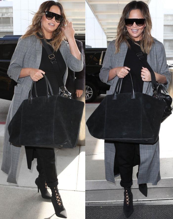 04e76a0767d80 Chrissy Teigen wearing Yeezy Season 5 knit sock boots with a black ...