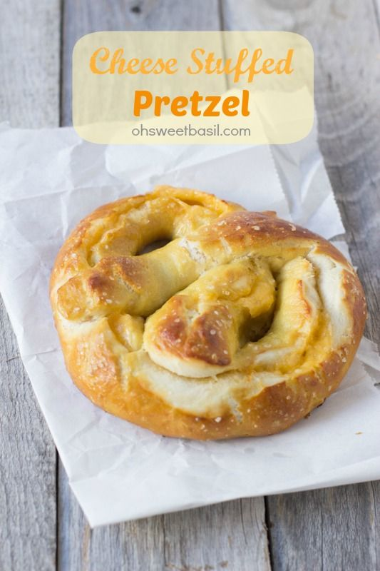 The best soft pretzel recipe and it happens to be stuffed with melty cheese. It's prefect for snacking on before or after trick-or-treating! ohsweetbasil.com