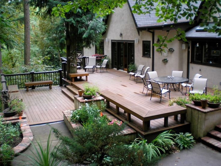 A platform deck blends with the yard and patio spaces with ease.
