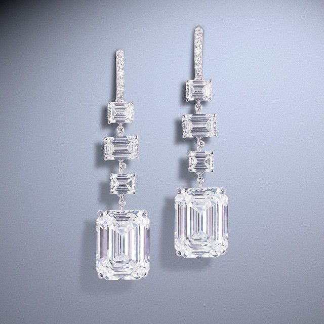 Over 11 carat each emerald-cut diamond Moussaieff earrings set with emerald-cut and round diamonds.