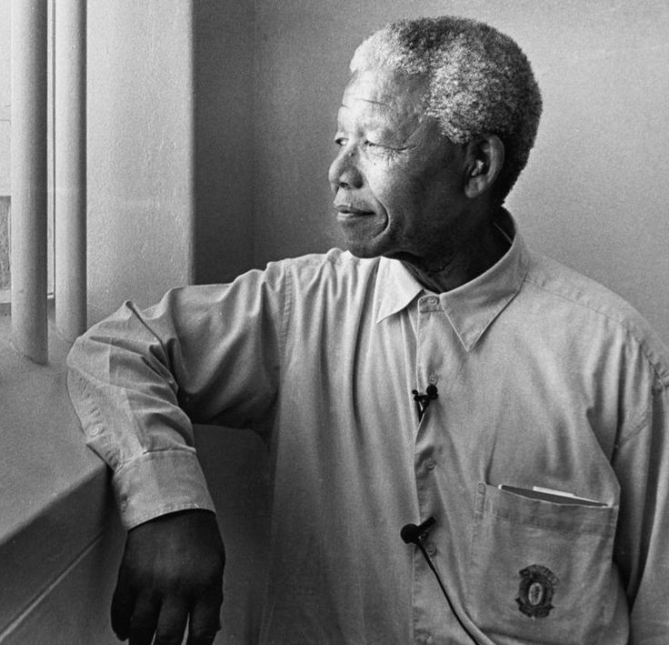 Photo by Jürgen Schadeberg (born 1931), 1994, Nelson Mandela in his cell on Robben Island (revisit).