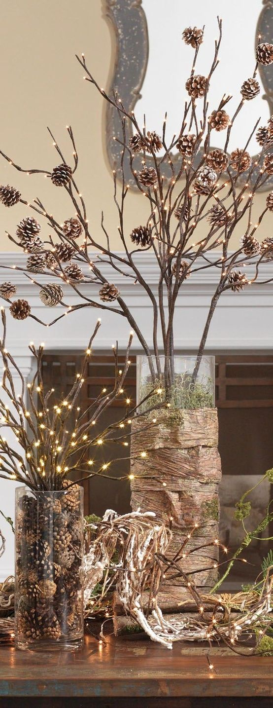 Fall/Thanksgiving decor that can go into the Christmas season- lighted branches in vases filled with pinecones or covered in bark. Love all the natural elements!