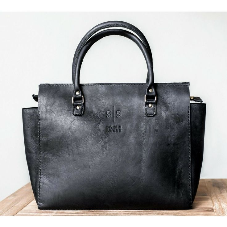 & Finally we can introduce the hand stitched leather handbag -  Naomi in black!  She is bold & fierce. Featuring a luxury suede lining & inner pocket.   Get her now.  www.swish-swank.com