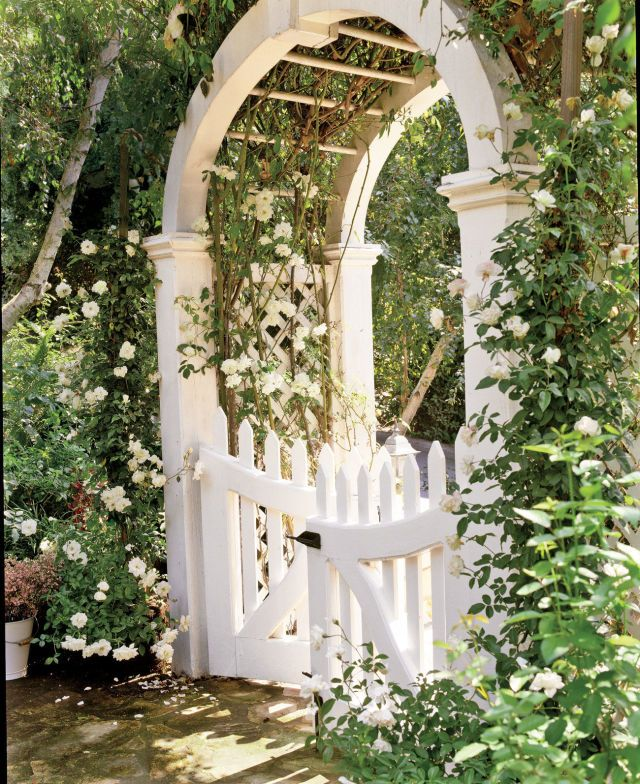 For a majestic garden gate, try a white barreled archway.