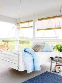 Bed swing on cozy porch