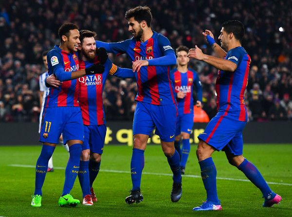 Lionel Messi (2ndL) of FC Barcelona celebrates with his team mates Neymar Jr. (L) Andre Gomes (2ndR) and Luis Suarez after scoring from the penalty spot his team's second goal during the Copa del Rey quarter-final second leg match between FC Barcelona and Real Sociedad at Camp Nou on January 26, 2017 in Barcelona, Catalonia.
