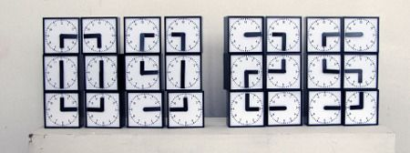 The Clock Clock, reloj digital hecho con relojes analógicos