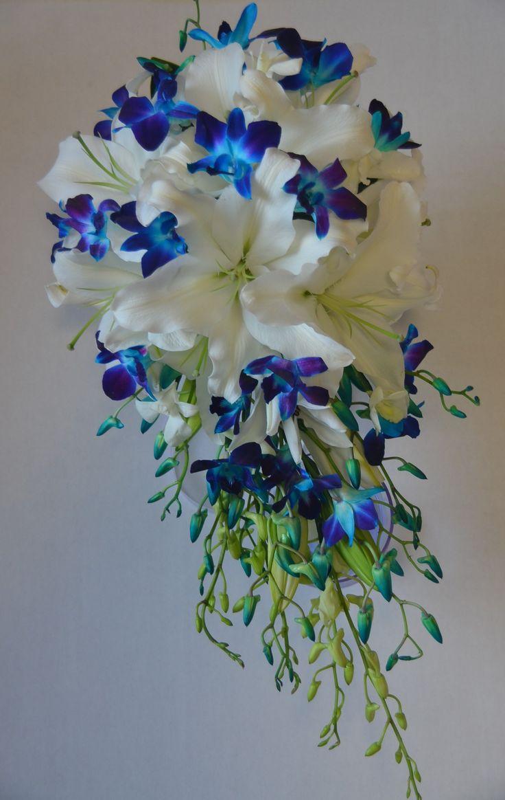 Blue Singapore orchids white oriental lily teardrop wedding bouquet