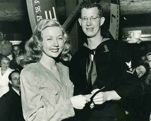 Historic Photograph of Actress Gloria Grahame Hands A Sailor A $25 War Bond That He Won During The Nightly Raffle At The Hollywood Canteen.