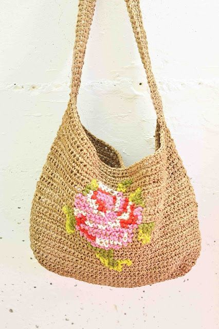 "Crocheted Raffia Bag with Cross Stitch Embroidery by Maize Hutton. Maize used this free Ravelry pattern for the bag and ""winged""..."