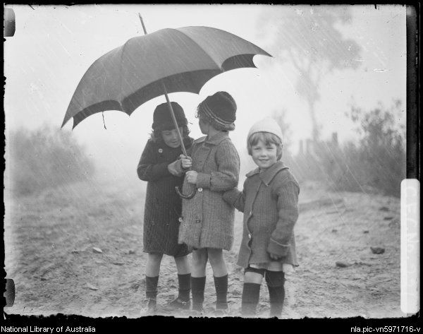 Cazneaux, Harold, 1878-1953. Beryl, Jean and Rainbow under an umbrella, Wentworth Falls, New South Wales, 1915 [picture]