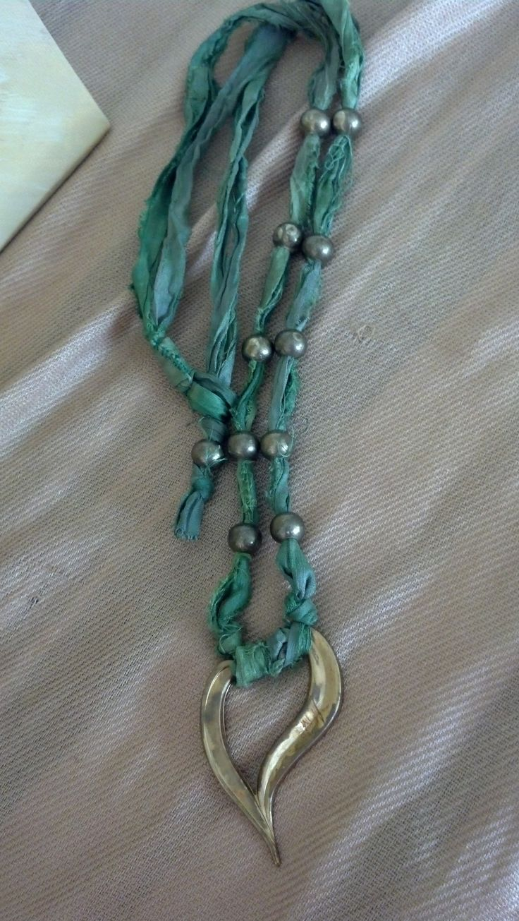 Green beaded recycled sari ribbon necklace with vintage brass heart.....www.thelaurelhouse.etsy.com