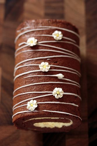 Chocolate roll cake with flowers