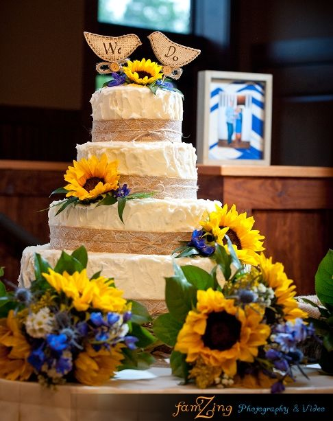 rustic wedding cake with burlap  lace  sunflowers  and