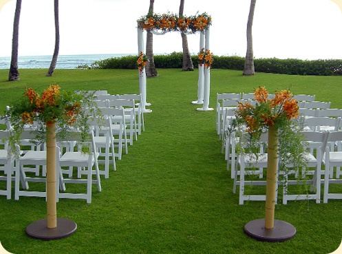 #Hawaii wedding ceremony decor #tropical wedding flowers #bamboo poles with base [avoid holes in lawns]