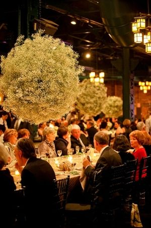 Hanging balls of Baby's breath (not this large though) hanging on either side of the chandeliers