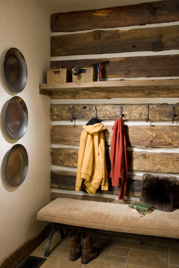 Monroe Metalsmithing provided hooks crafted from reclaimed iron from railroad tracks in the mudroom/foyer.  Love this wall covered with old barnwood