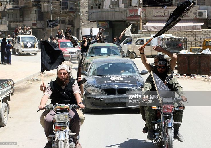 Fighters from Al-Qaeda's Syrian affiliate Al-Nusra Front drive in the northern…
