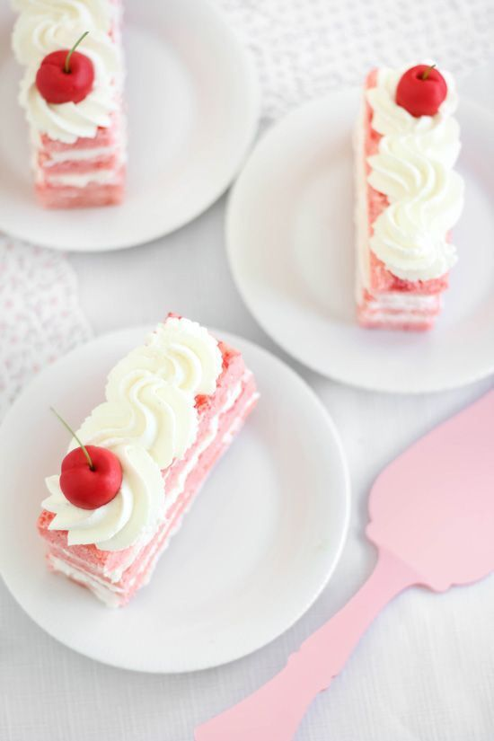 Cherry topped layer cake slices. Prettiest cake EVER!