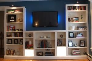 These 23 IKEA BILLY bookcase hacks share how you can transform your home with customized storage that fits your space, style, and budget.: BILLY Media Center Hack