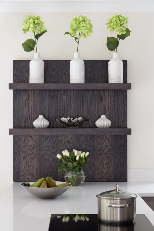 Matching stained oak floating shelves.