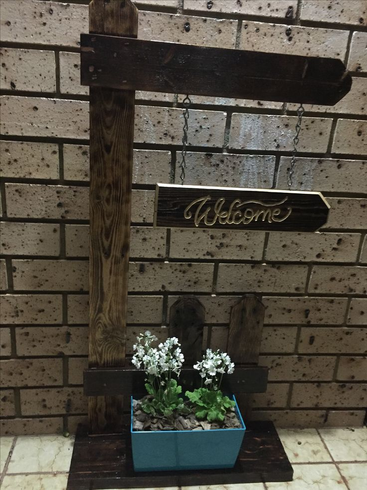 Finished welcome sign for front door, and a plant to top it off..