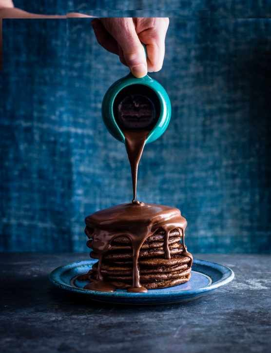 These light and fluffy Nutella pancakes are simply delicious and come drizzled in a smooth and creamy hot chocolate sauce. Adding booze to the sauce is optional but highly recommended for an extra treat! Includes a nifty how-to video