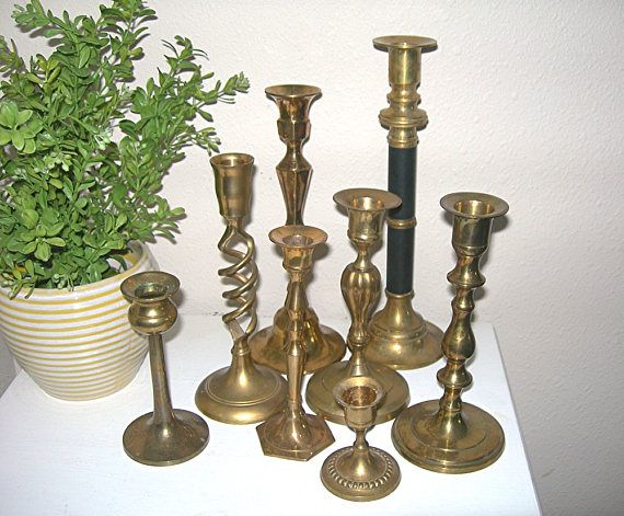 Mixed lot of 8 vintage brass candle holders - All are different shapes and heights; tallest is 10 inches and shortest is 2-3/4 - These are perfect to use for weddings - So versatile for home & mantle décor - Red, green, or white candles will makes these perfect for your Christmas and holiday décor - Yellow, orange, and brown candles for the Thanksgiving table - Unpolished, as found  All are in excellent, undamaged condition. Ive tried to clean up any wax spillage, but you will likel...
