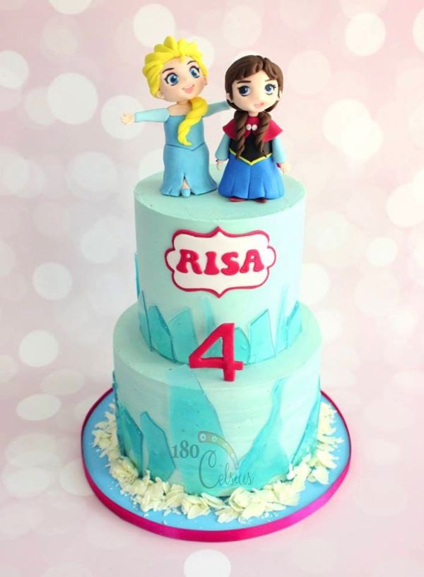 This Frozen Cake features a Chibi Queen Elsa and Princess Anna on a multi-tiered cake.