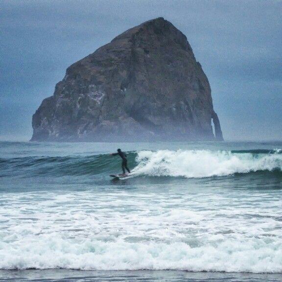 Surfer at Haystack Rock,  Pacific City Oregon. #surfers #surfing #surfer #haystackrock #PacificCity #Oregon #travel #travelphotography #nikon #afar #natgeo #lonleyplanet #traveler_magazine #photooftheday #worldtraveler #traveler_stories #traveler_magazine #wanderlust