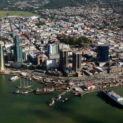 Port Of Spain, capital of Trinidad & Tobago.  In the Lesser Antilles Islands chain. Population just over 1 million, with 300,000 in Port of Spain.