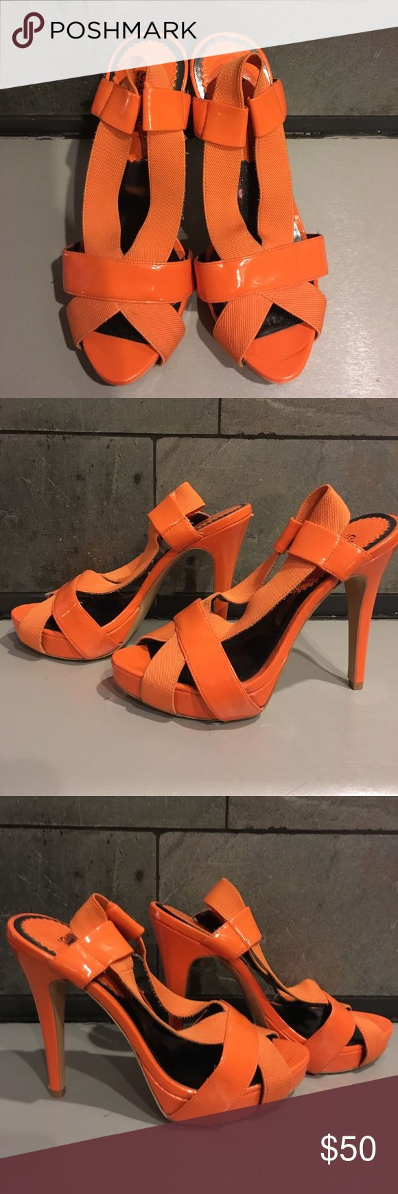 Charles David Orange Platform Sandals Charles David Orange Platform Sandals. Worn a few times, good condition , a few tiny marks here and there. Sorry no trades but reasonable offers considered. I also have these In black in my closet! Thank you Charles David Shoes Sandals
