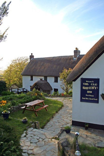 The 13th Century thatched Old Smithy Inn, Welcombe, north Devon, England. 'A ploughman's lunch and a frothy pint of real local ale'
